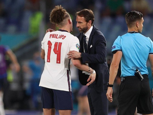Leeds United midfielder Kalvin Phillips embraces England head coach Gareth Southgate. Pic: Getty