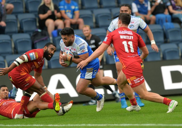 Rhyse Martin goes over to score Leeds Rhinos' opening try against Catalans Dragons last week. Martin will miss the rematch on Friday due to suspension. Picture: Jonathan Gawthorpe.
