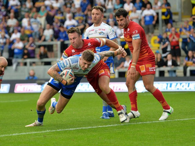 Liam Sutcliffe goes over for a try against Catalans last week. Picture by Jonathan Gawthorpe.