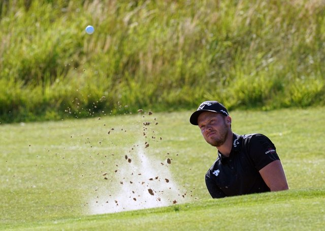England's Danny Willett chips out of a bunker on the 6th. Picture: PA