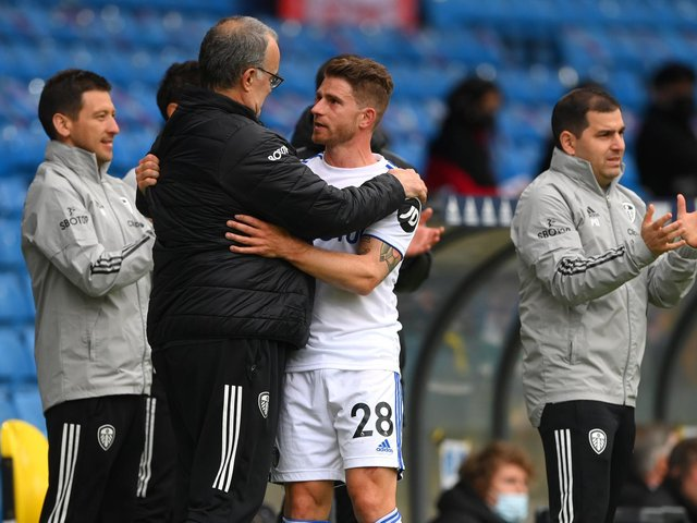 WINNING TEAM: Leeds United head coach Marcelo Bielsa, left, and outgoing former Whites defender Gaetano Berardi, right, share an embrace after Berardi's final game for Leeds against West Brom. Photo by Stu Forster/Getty Images.