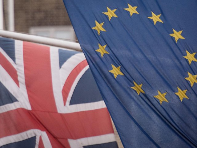 File photo of the EU and Union flags.