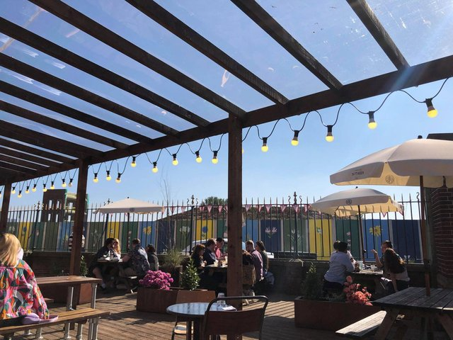 The beer garden was bright and colourful in the sunshine.