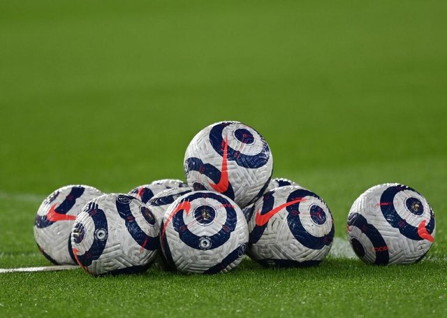 Premier League match balls. (Photo by Shaun Botterill/Getty Images)