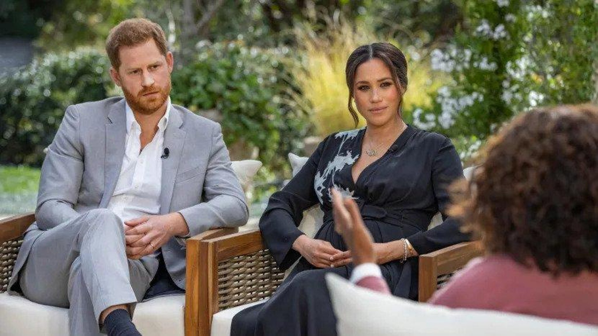 Who is Meghan Markle referring to when she says The Firm during interview with Oprah Winfrey
