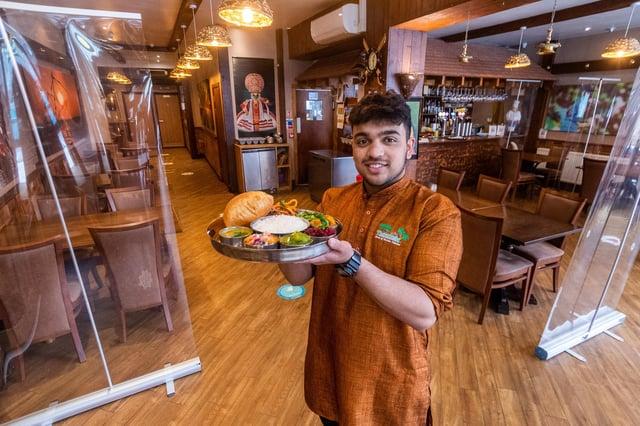 Tharavadu, Mill Hill, Leeds, which serves Keralan cuisine. Pictured: Waiter Abijith Ajith, holding dish Tharavadu Sadya.
