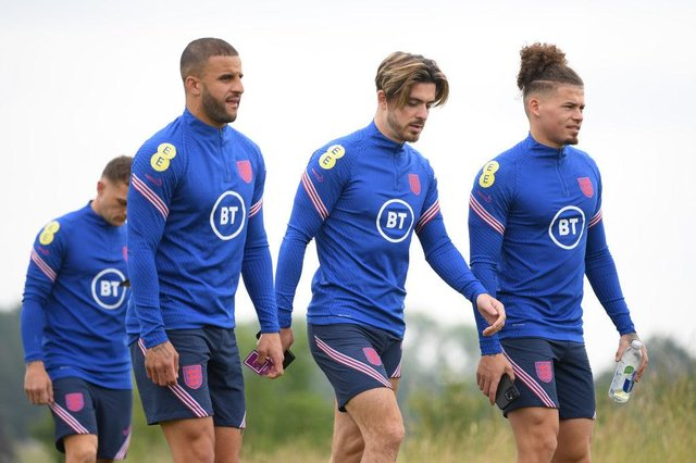 Kyle Walker, Jack Grealish, and Kalvin Phillips of England. (Photo by Michael Regan/Getty Images )