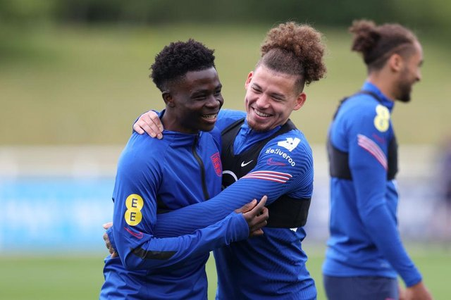 Bukayo Saka and Kalvin Phillips. (Photo by Catherine Ivill/Getty Images)