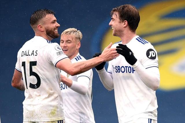 Patrick Bamford of Leeds United celebrates with Stuart Dallas and Ezgjan Alioski. (Photo by Oli Scarff - Pool/Getty Images)