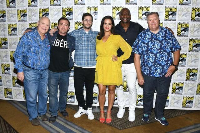 The cast of Brooklyn Nine-Nine: Dirk Blocker, Joe Lo Truglio, Andy Samberg, Melissa Fumero, Terry Crews and Joel McKinnon Miller at 2019 Comic-Con International. (Pic: Getty Images)