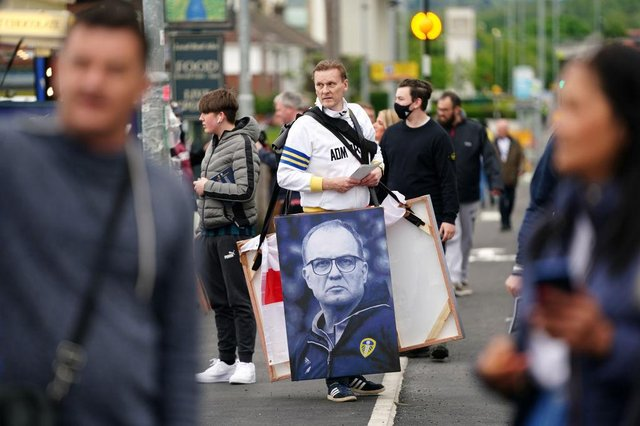 A vendor is seen selling art work of Marcelo Bielsa, Manager of Leeds United. (Photo by Jon Super - Pool/Getty Images)